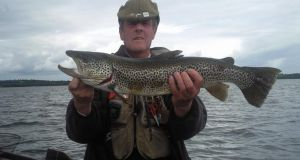 Mick Kelly with a magnificent trout from Lough Sheelin