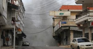 Smoke rises after what activists said was shelling by forces loyal to Syria's president Bashar al-Assad in the Armenian Christian town of Kessab on April 4th. The Syrian border overrun by militant rebel groups last month. Photograph: Reuters