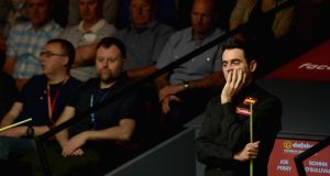 Ronnie O'Sullivan is two frames down to Joe Perry in the second round of The Dafabet World Snooker Championship at Crucible Theatre  in Sheffield. Photograph:  Gareth Copley/Getty Images