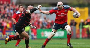 Munster's Paul O'Connell  dends off  Toulouse's Guthro Steenkamp during the Heineken Cup quarter-final at Thomond Park. Photo:  Brian Lawless/PA