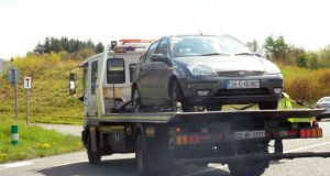 The grey/silver Ford Focus car, in which the men had been travelling, was found at the viewing car park at Lough Owel near Mullingar. Photograph:  Willie Farrell.