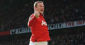Manchester United's Wayne Rooney his first against  Norwich City at Old Trafford. Photograph: Peter Powell / EPA