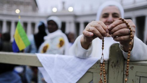 A nun prays with her rosary beads in St Peter's Square. Photograph: Riccardo Antimiani/EPA