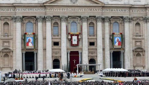 Tapestry portraits of John Paul II (L) and Pope John XXIII are seen during the canonisation ceremony in St Peter's Square at the Vatican. Photograph: Giampiero Sposito/Reuters
