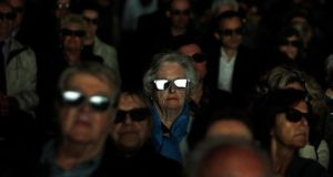 Catholics wear 3D glasses as they watch the screening of the canonisation ceremony of Pope John XXIII and John Paul II at the Parish church in Sotto il Monte Giovanni XXII, which is the hometown of John XXIII. Photograph: Alessandro Garofalo/Reuters