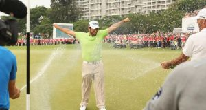 Alexander Levy receives the traditional  champagne reception from his French colleagues after winning  the 2014 Volvo China Open at Genzon Golf Club in Shenzhen. Photograph: Ian Walton/Getty Images