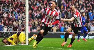 Connor Wickham  celebrates scoring his second goal with Sunderland captain John O'Shea  during the  Premier League match  at the Stadium of Light. Photograph: Mark Runnacles/Getty Images