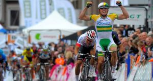 Orica Greenedge  rider  Simon Gerrans of Australia  celebrates after winning the Liege Bastogne Liege cycling race from Liege to Ans in Belgium. Photograph: Nicolas Bouvy/EPA