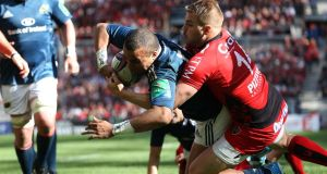 Munster's Simon Zebo scores a try despite Toulon's Drew Mitchell tackle during the Heineken Cup semi-final at the  Stade Velodrome in Marseille. Photograph: Billy Stickland/Inpho