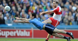 Dublin's Rory O'Carroll fails to block a shot from Emmett McGuckin of Derry during the National Football League Division One final at Croke Park. Photograph: Tommy Grealy/Inpho.