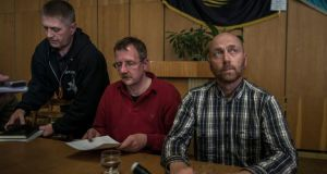 Vyachislav Ponomaryov (left), the self-appointed mayor of Slovyansk, and Col Axel Schneider of Germany (right), the leader of a group of European military observers held by Ponomaryov's group, during a news conference at city hall in Slovyansk, Ukraine, yesterday. Photograph: Sergey Ponomarev/The New York Times