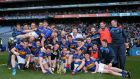 The Tipperary team celebrate with the trophy after winning the Division Four final. Photograph: Inpho