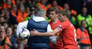 Chelsea manager Jose Mourinho keeps the ball from Liverpool's Steven Gerrard during yesterday's match at Anfield. Photograph: Peter Powell/EPA