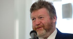 Dr James Reilly: Minister told health insurers in recent days that he would introduce a concept known as lifetime community rating from next year. Photograph: Bryan O'Brien