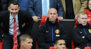 Manchester United interim manager Ryan Giggs sitting in the dug out with Paul Scholes and Nicky Butt during the match against Norwich
