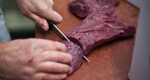Peter Wisker cutting horsemeat. Photograph: Ilvy Njiokiktjien/AFP/Getty Images