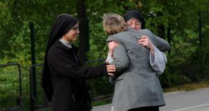 Nuns comfort a member of the public outside Corpus Christi Catholic College, Neville Road, Leeds, where a 15-year-old boy was arrested after a woman teacher was stabbed to death at the school.  Photograph: Lynne Cameron/PA Wire