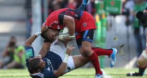 Toulon's Bryan Habana is tackled by Munster's Simon Zebo during the Heineken Cup semi-final. Photo: Billy Stickland/Inpho