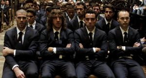Barcelona players  attend the funeral ceremony for Francesc 'Tito' Vilanova at Barcelona's Cathedral on Monday evening. Photograph: Toni Albir/EPA