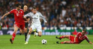 Real Madrid's Gareth Bale holds off Javi Martinez  as Philipp Lahm slides in during last week's first-leg game at the Bernabeu.