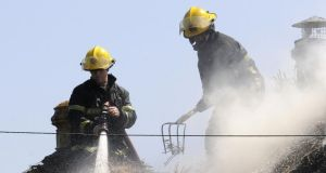 Firefighters deal with a fire in an unoccupied thatched cottage in Portmarnock, Co Dublin last year.  Photograph: Dave Meehan/The Irish Times