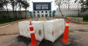 Cones and barricades sit at the entrance to Olympic Park, the primary set of venues being built for the Rio 2016 Olympic Games, earlier this month as more than 2,000 workers went on strike at the site. Photograph: Mario Tama/Getty Images