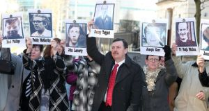 Relatives of those killed outside Belfast Coroner's Court last month at the start of a new inquest into the deaths of 10 people shot dead by British soldiers in Ballymurphy in 1971. Photograph: PA Wire