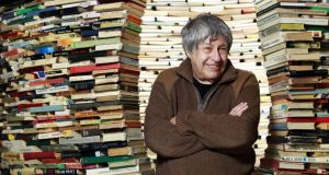 Bounded by books: Ivan Klíma. Photograph: Tomas Krist/Isifa/Getty