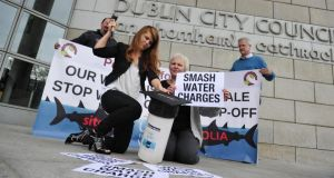 People before Profit local election canditates Kim O'Donnell, Brid Smith, Paul Shields and Andrew Keegan protesting about water charges outside Dublin city council Offices. Photograph: Aidan Crawley
