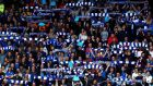 Cardiff City fans show their support during the Premier League match against Stoke City at Cardiff City Stadium. Photograph:  Michael Steele/Getty Images