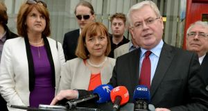 Tánaiste Eamon Gilmore and Labour Party colleagues on the campaign trail. Photograph: David Sleator