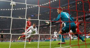 Real's Sergio Ramos, second left, scores his side's second  goal past Bayern goalkeeper Manuel Neuer during the Champions League semi-final second leg  at the Allianz Arena ,  Munich. Photograph: AP.