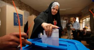 A woman casts her vote at a polling station during a parliamentary election in Baghdad. Iraqis headed to the polls on Wednesday in their first national election since US forces withdrew from Iraq in 2011, with Prime Minister Nuri al-Maliki seeking a third term amid rising violence. Photograph: Ahmed Saad/Reuters
