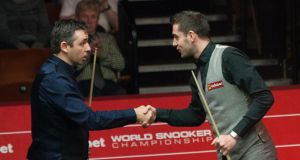Mark Selby shakes hands with Alan McManus after  their quarter-final in Sheffield. Photograph: Tim Goode/PA Wire