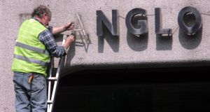 Minister for Public Expenditure Brendan Howlin said today 'there is a compelling demand from the public to know what happened' during the banking collapse.  Photograph: Bryan O'Brien/The Irish Times  20/04/2011 NEWS / FINANCE Ken Glennon of Wayfinding removes the Anglo Irish Bank signage and lettering from the Anglo Irish bank Deadquarters Office in St Stephen's green Dublin yesterday. Photograph: Bryan O'Brien / THE IRISH TIMES