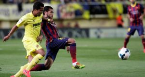 Barcelona's Dani Alves and Villarreal's Giovani Dos Santos fight for the ball during the match last Sunday.