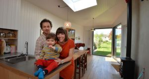David Beattie and Anne Bradley with their son Hugo in the new extension to their home in Terenure which came about as a result of the annual Simon Open Door initiative. Photograph: Alan Betson