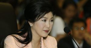 Thai caretaker Prime Minister Yingluck Shinawatra at a meeting with Election Commission officials at Royal Thai Air Force Academy in Bangkok on Wednesday. Photograph: Reuters