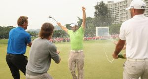 Alexander Levy celebrates after winning the 2014 Volvo China Open. The Frenchman says the pressure is off now, ahead of  The Championship at Laguna National in Singapore. Photograph:  Ian Walton/Getty Images