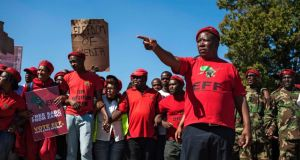 Economic Freedom Fighters leader Julius Malema points the way to supporters in Johannesburg on Tuesday. Photograph: Ihsaan Haffejee/EPA