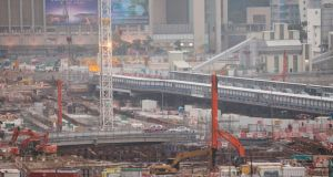 The construction site of the Hong Kong to Guangzhou cross-border high speed rail link terminus, West Kowloon, Hong Kong, China, Chinese economic growth is slowing after decades of double-digit percentage expansion.