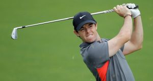 Rory McIlroy grimaces as he hits from the fairway to 16th green during the pro-am of the Wells Fargo Championship golf tournament at Quail Hollow Club in Charlotte, NC. Photograph: AP Photo