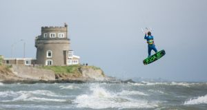 Adam McDonnell kitesurfing on Portmarnock strand at the launch of An Taisce's Clean Coasts Week, which takes place from May 9th to 18th. Photograph: Naoise Culhane