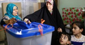 A woman casting her vote at a polling station in Baghdad. Iraqis headed to the polls yesterday in their first national election since US forces withdrew in 2011. Photograph: Reuters/Ahmed Jadallah