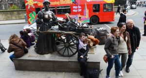 It has been one of the most popular spots in Dublin for tourists to pose by the Molly Malone statue in Grafton Street. Photograph: Cyril Byrne / THE IRISH TIMES