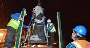 The Molly Malone statue being removed from its plinth  last night. Photograph: Dave Meehan