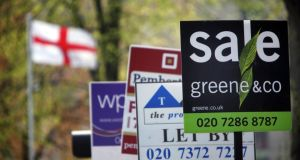Signs advertise properties for sale in London. Photograph: Jason Alden/Bloomberg News