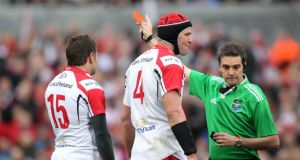 Jared Payne receives his red card from referee Jerome Garces during Ulster's Heineken Cup quarter-final against Saracens. Photograph: Darren Kidd/Inpho