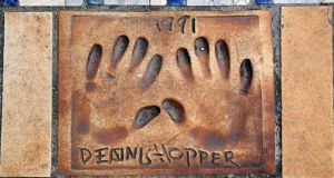 Handprints of cinema stars on the street in Cannes. Photograph: Rebecca Marshall/New York Times