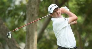 Peter Lawrie in action on day one of The Championship at Laguna National in Singapore. Photograph: Andrew Redington/Getty Images
